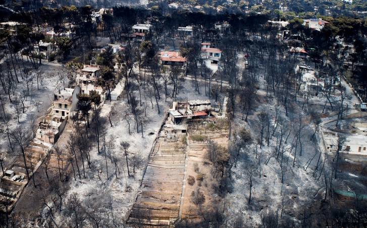 An aerial view shows burned houses and trees in the seaside village of Mati – Greece. Image courtesy of  Reuters/Eurokinissi