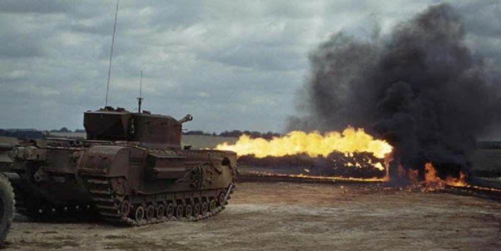 The Churchill Crocodile flame-throwing AVRE in bunker busting ops. Image courtesy of  Wikipedia
