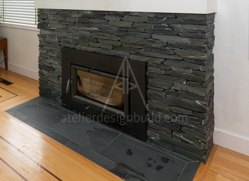 Locally quarried slate rock face with Montauk slate hearth