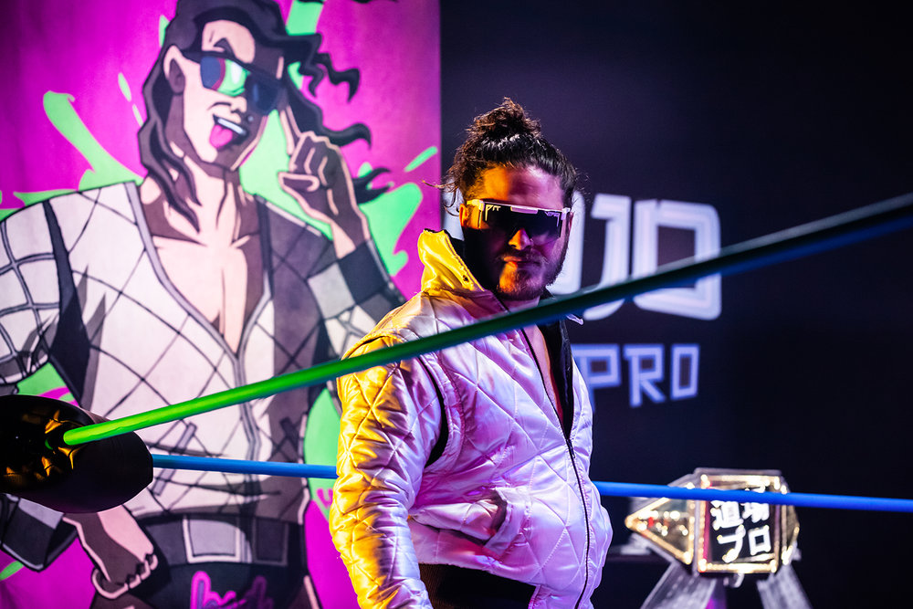 Joey Janela sizing up the crowd after entering the ring.