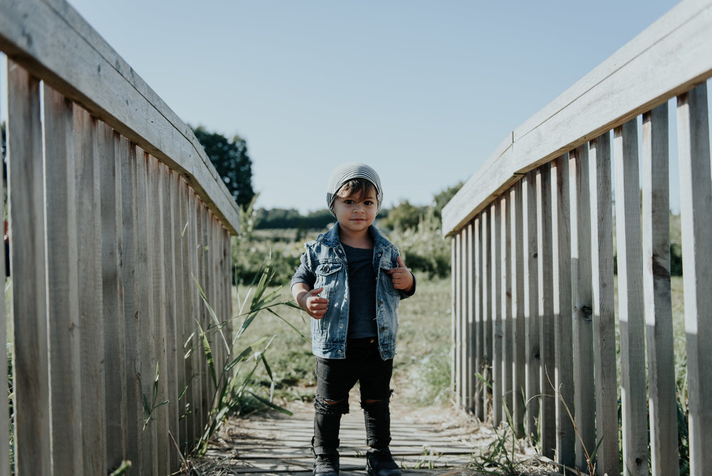 vest & jeans : @tattrdthreads, long sleeve :@vonbonapparel, toque :@northkinder (from @watermelontreekids, shoes are nike.