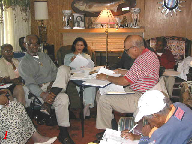 (Left-right) Dorothy Stewart, Vern Stewart, Edris Dade, Chapter President Onnis Berryman, Pauline Berryman Wesley & Sadie Williams (front) hammer out reunion details at the final pre-reunion planning meeting in June, 2004.