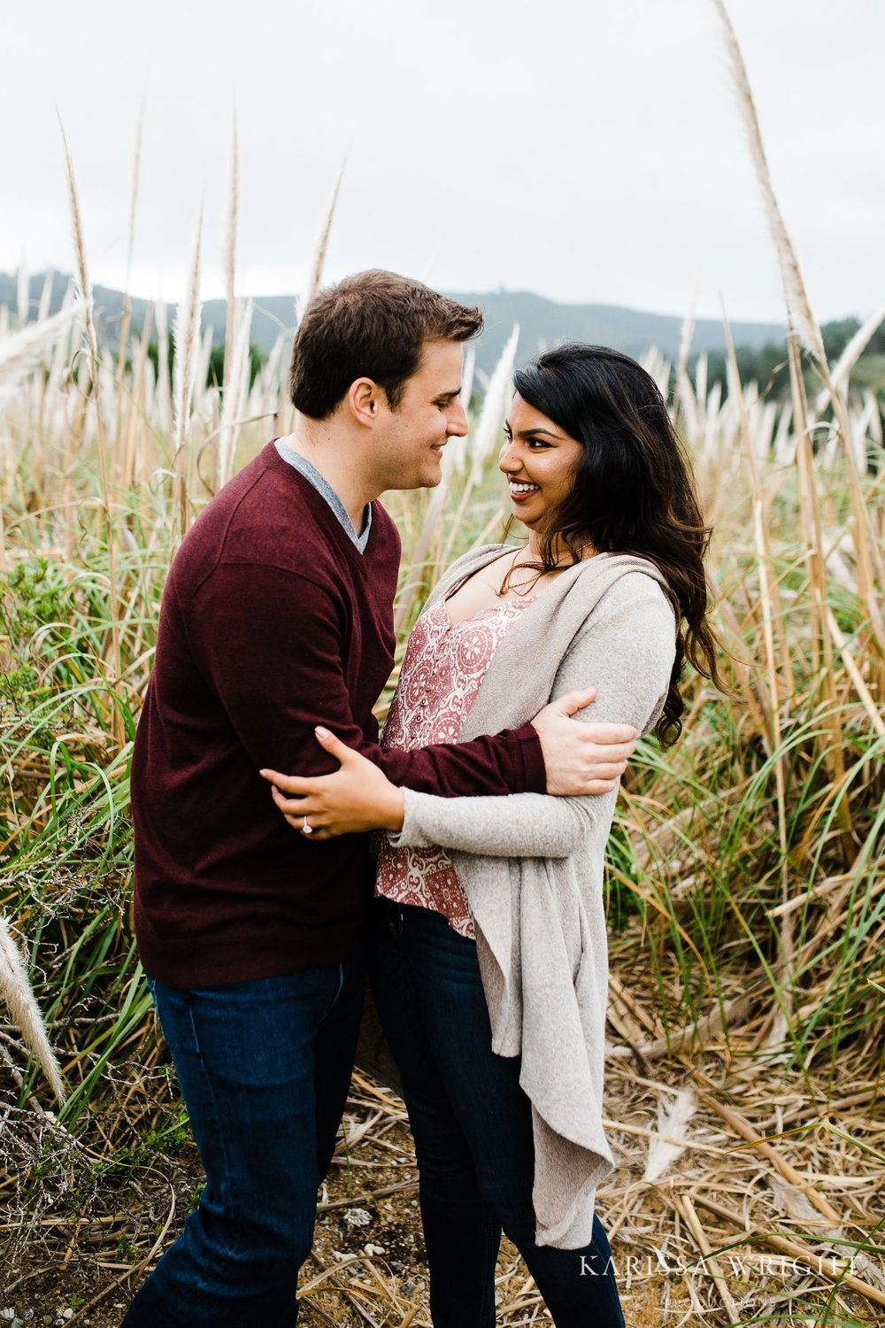 Alex grabs Lipika during their engagement session and she laughs a out loud at their fun and loving relationship.