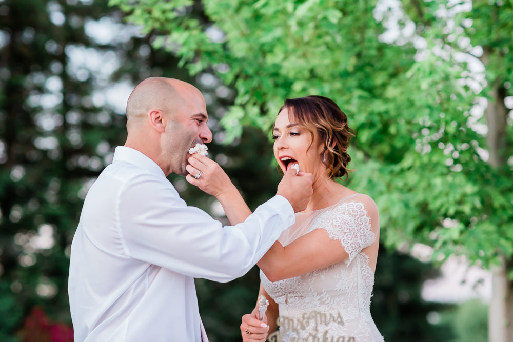 Cake Cutting in their Outdoor Summer Wedding