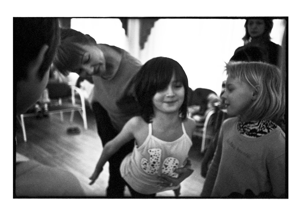Ekaterina discovering Zina, an orphaned girl with natural talent for ballet. Through an administrative error Zina (center) and her friend (right) were send to an orphanage for severely mentally disabled children.