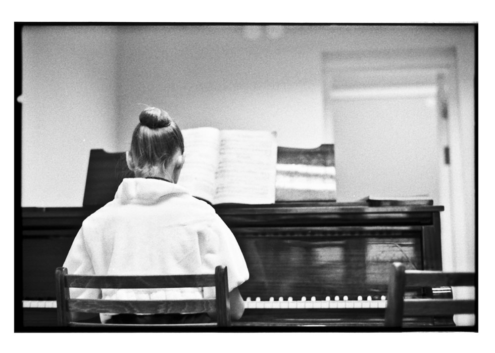 Tatiana at the piano during one of her music classes.