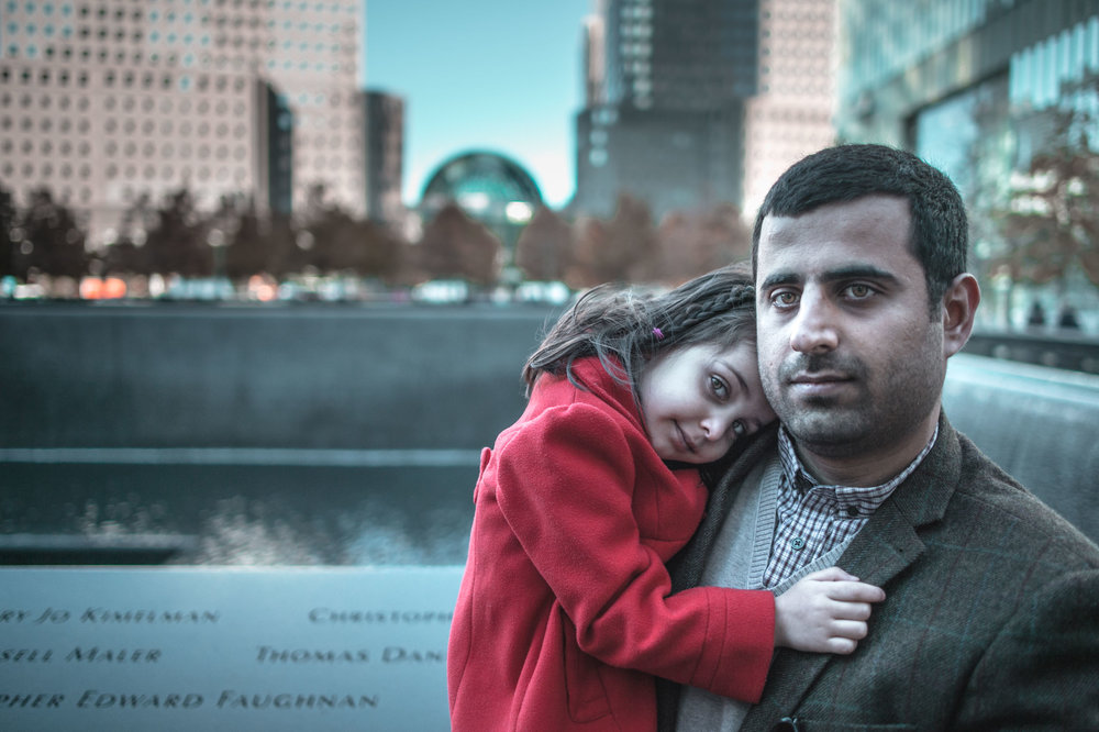 Hayder Al-Khoei , an Iraqi immigrant visiting the 911 Memorial with his young daughter.