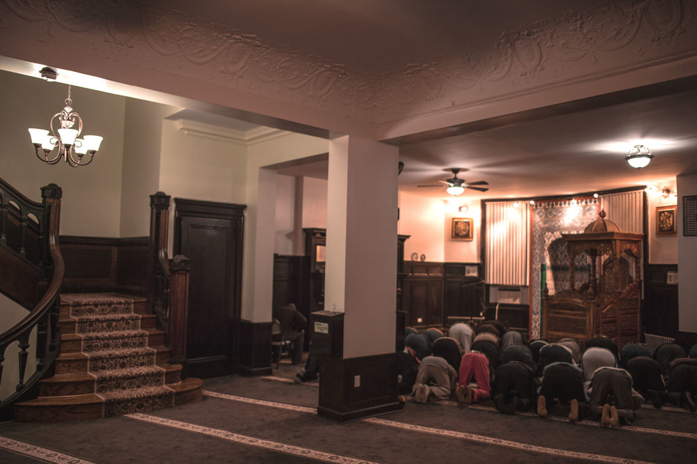 Men at prayer in the Islamic Cultural Center on Riverside Drive, the oldest Mosque on Manhattan.
