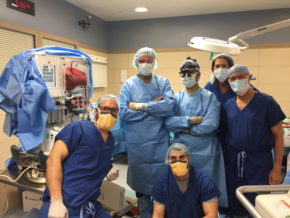 University of Wisconsin Principal Investigator Dr Anthony D'Alessandro and the team with the metra device during the first transplant (photograph courtesy of David Sohl)