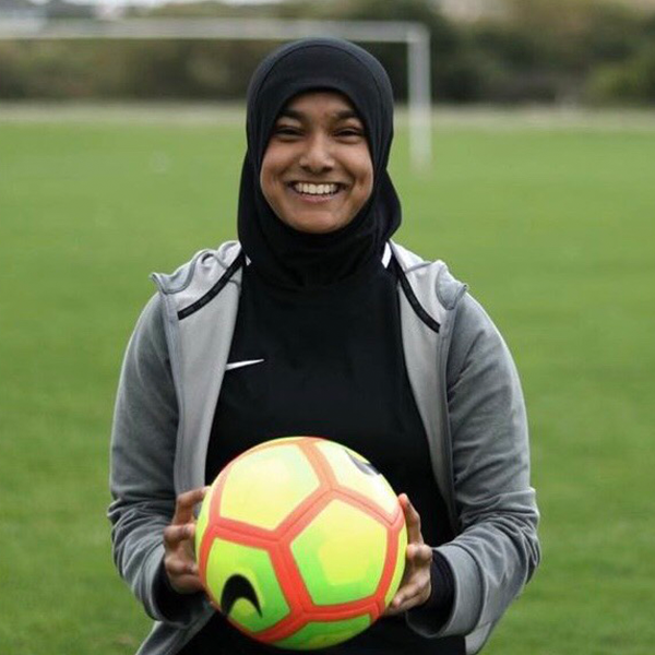 Lipa Nessa, Youth Ambassador, Youth Sports Trust - My name is Lipa Nessa and I'm going to change the world with a hijab on my head and a ball at my feet. I thought of this quote whilst in my first year of university, and now I'm in my third year of university studying sports business and coaching. Before coming to university I played for my local ladies football team. I am currently a grassroots coach at Kinja FC and the head of the development centre there. I wanted to take my knowledge and passion further and joined Youth Sport Trust's youth board and Middlesex FA youth board. That way my voice would be heard at county and national level.Being a woman in sport is one barrier but when you infused this with the rest of me being of colour and Muslim, people doubt you and your knowledge. They label you as plastic fan, or they paralyse in shock. Why do we as women in sport have to act tough or be way better than our counterparts to be deemed as a professional? I used to play, I now coach and I study football. My advice would be, if you're passionate about something and you're determined to achieve it nothing can stop you but yourself. Comments and hate will come and go but one day it will be worth it as your name will be written in history.