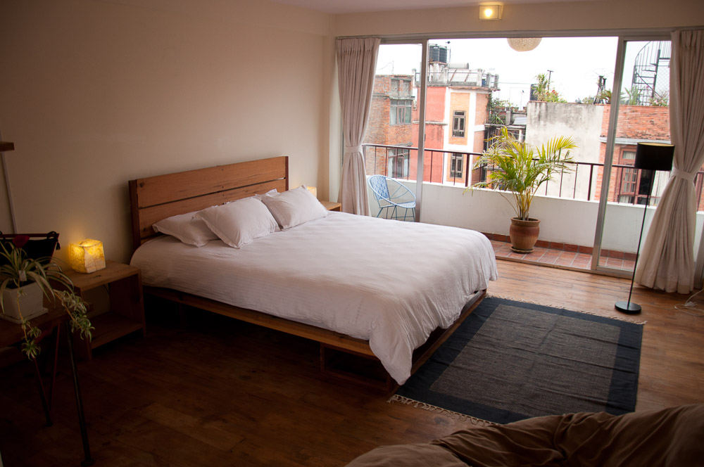 Master bedroom with king-bed and beautiful view over Patan on both side of the room