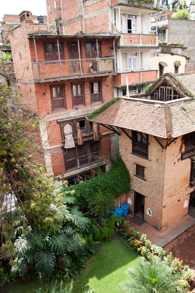 View from the bedroom window. Typical Newari House and beautiful garden.