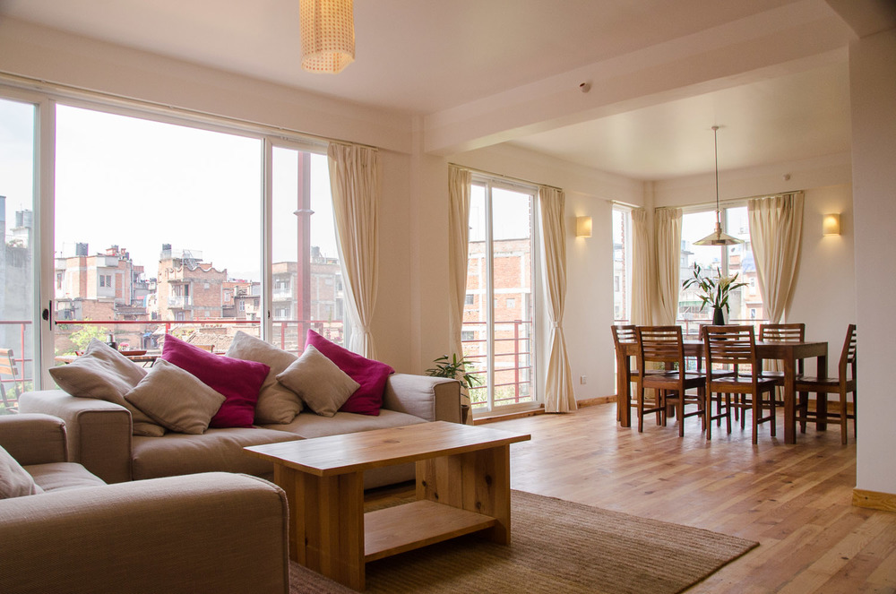 Spacious and bright living room with balcony and full lenght windows