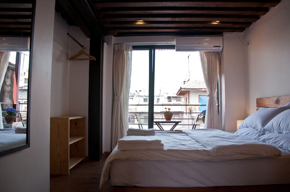 Bedroom with AC and balcony