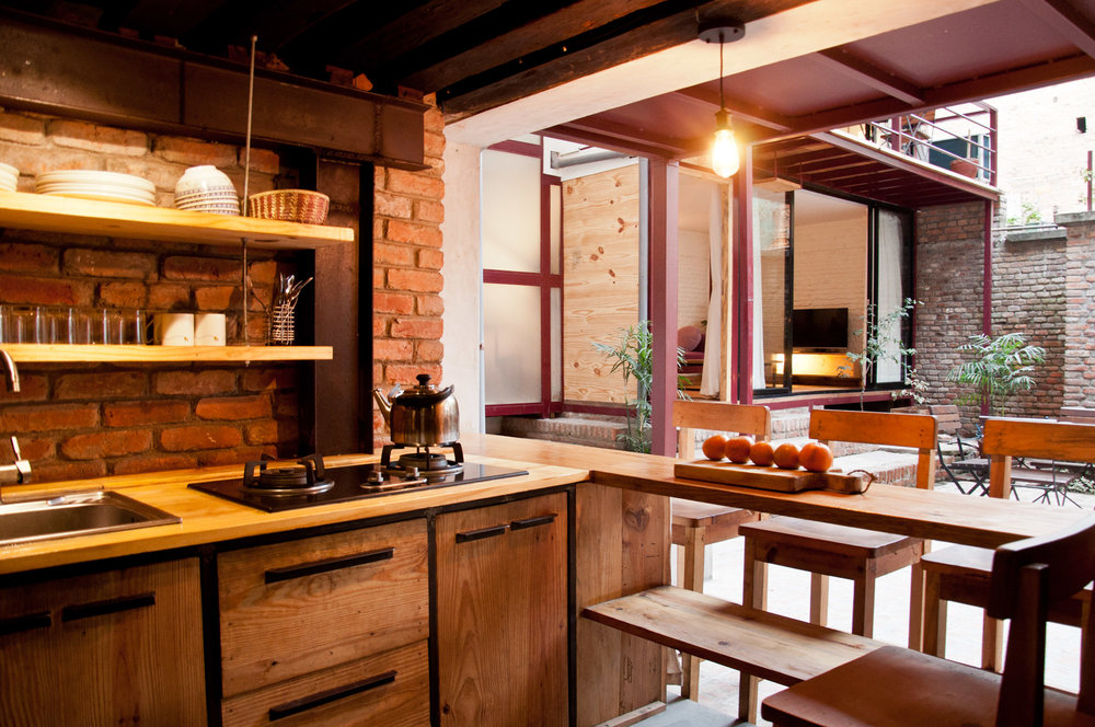 there is well equipped kitchen inside the premises of courtyard cottage.