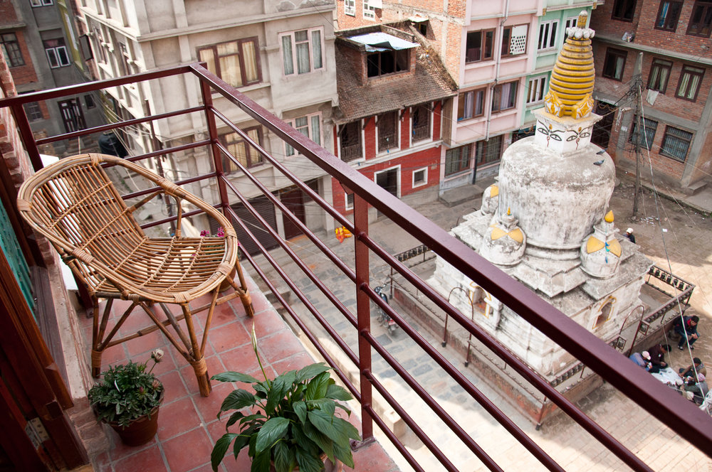 Small balcony on the kitchen side with a view over a beautiful ancient Stupa.