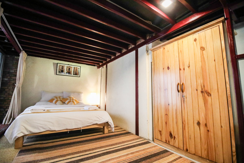 Guests can store their clothes or valuables in wooden cupboard.