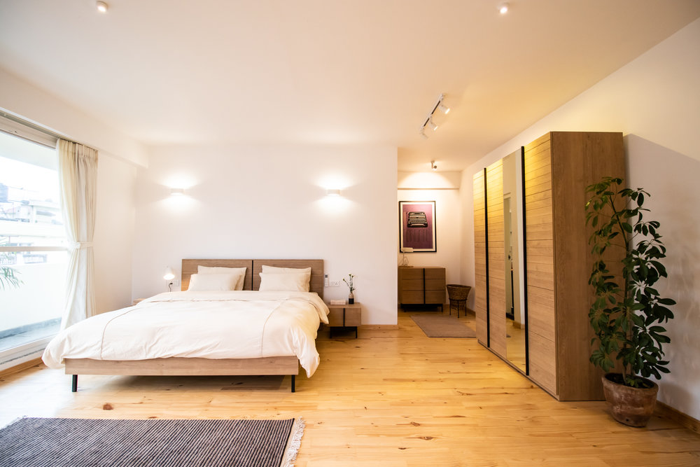 Master bedroom with wooden cupboard to hang your clothing sets.