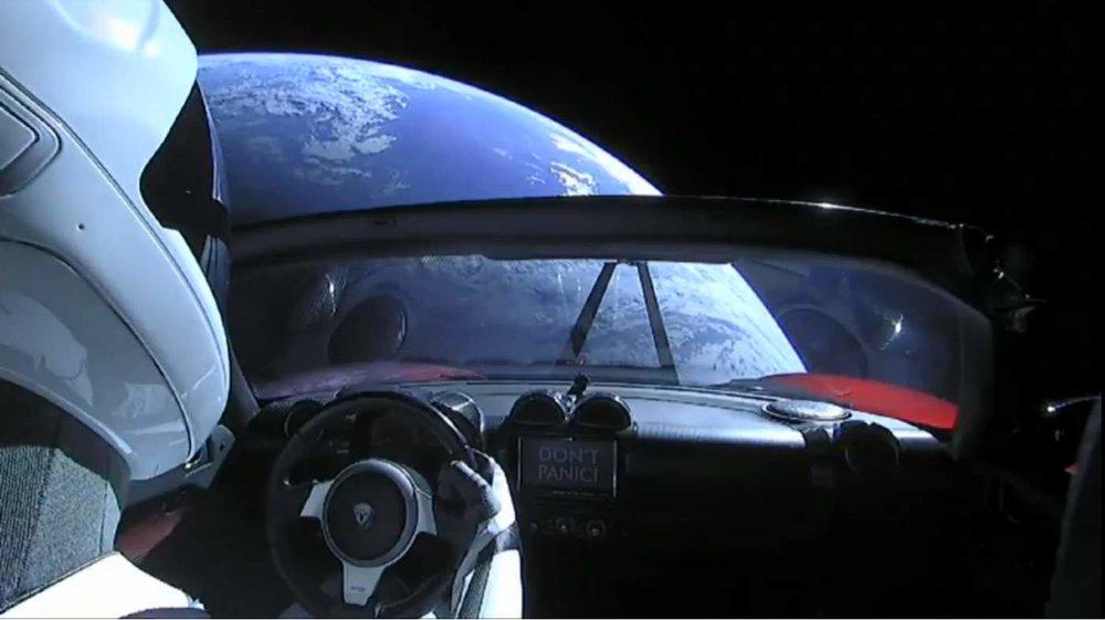 Falcon-Heavy-Test-Flight-Tesla-in-space-Starman-and-Earth.jpg