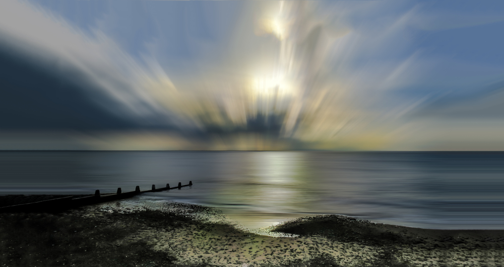 Tywyn Beach at sunset (long exposure effect)