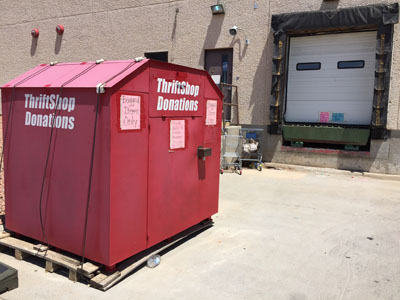 The red donation bin is located along Haan Rd, adjacent to Freedom Crossing and the main Fort Bliss Post Office.
