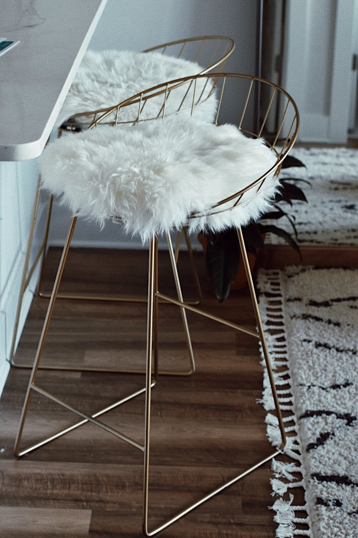 gold trim faux fur bar stools.JPG