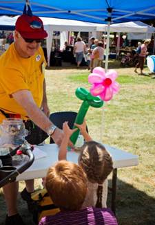 Dr. Bob creates balloon magic in the ARTiKids area.jpg