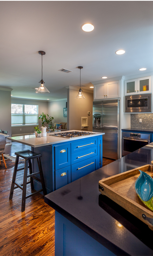 By using an open floor plan, this small kitchen feels bigger and can easily serve as a gathering point in the home.