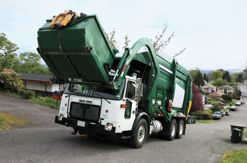 Front lift refuse truck in suburbs_LR (1).jpg