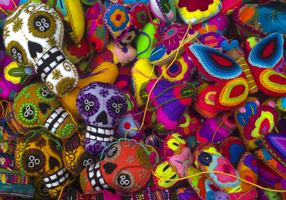 Handmade stuffed animals and skulls in the Artisanal Market.