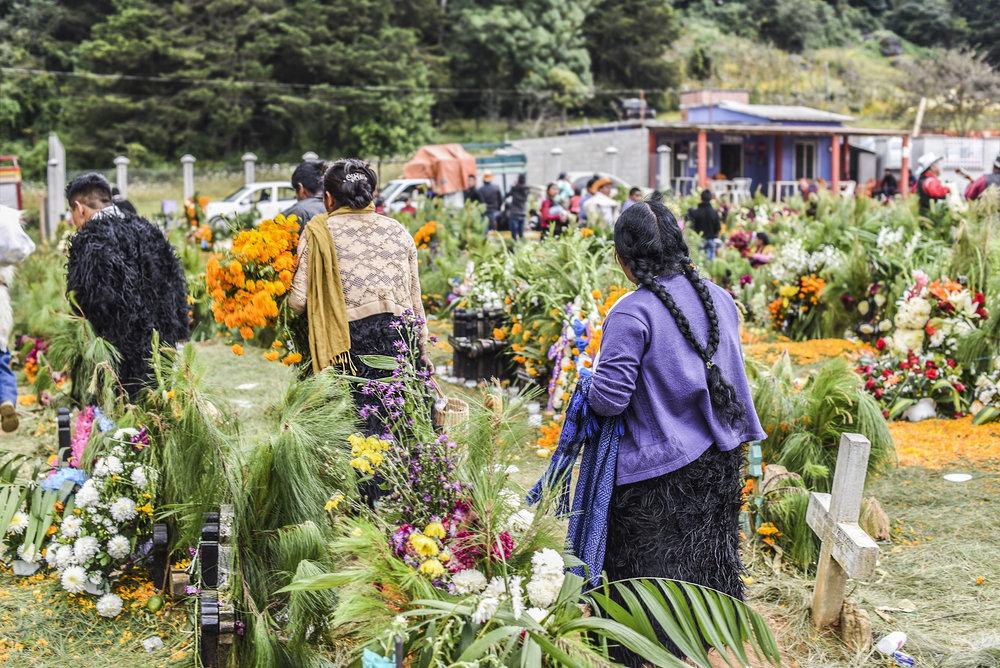 Women in cemetary celebrating Dia de los Muertos. San Juan Chamula, Chiapas, MX.