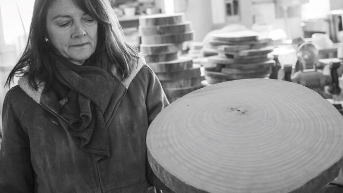 Lori making a large cutting board