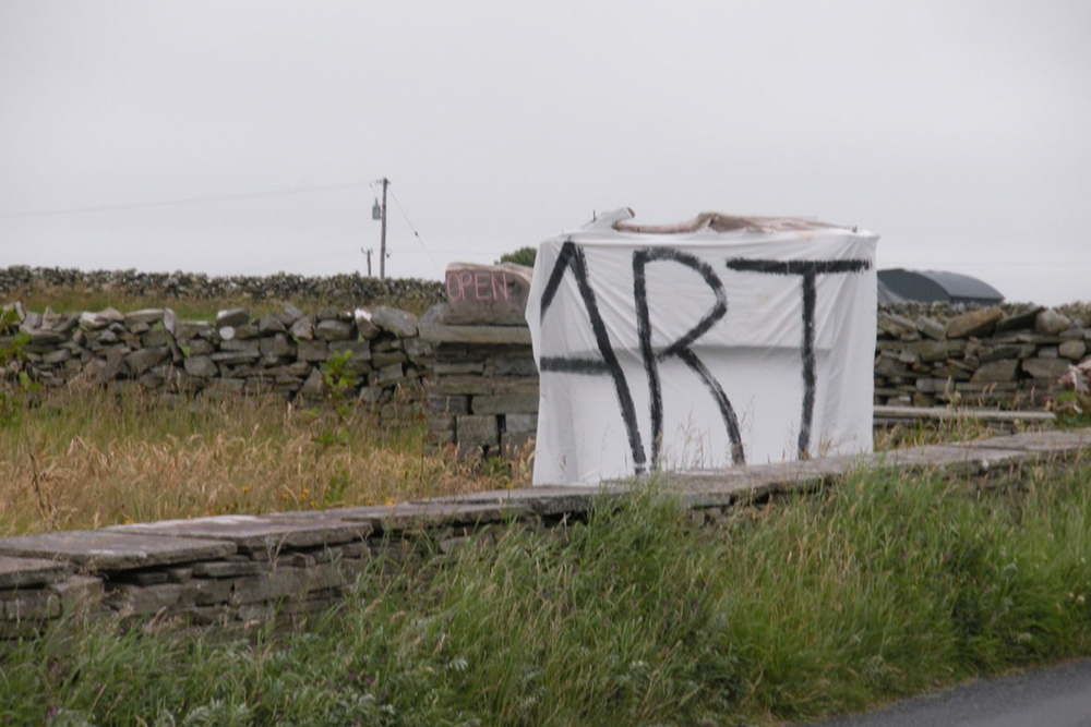 A documentary photograph of a sign promoting art in the west of ireland