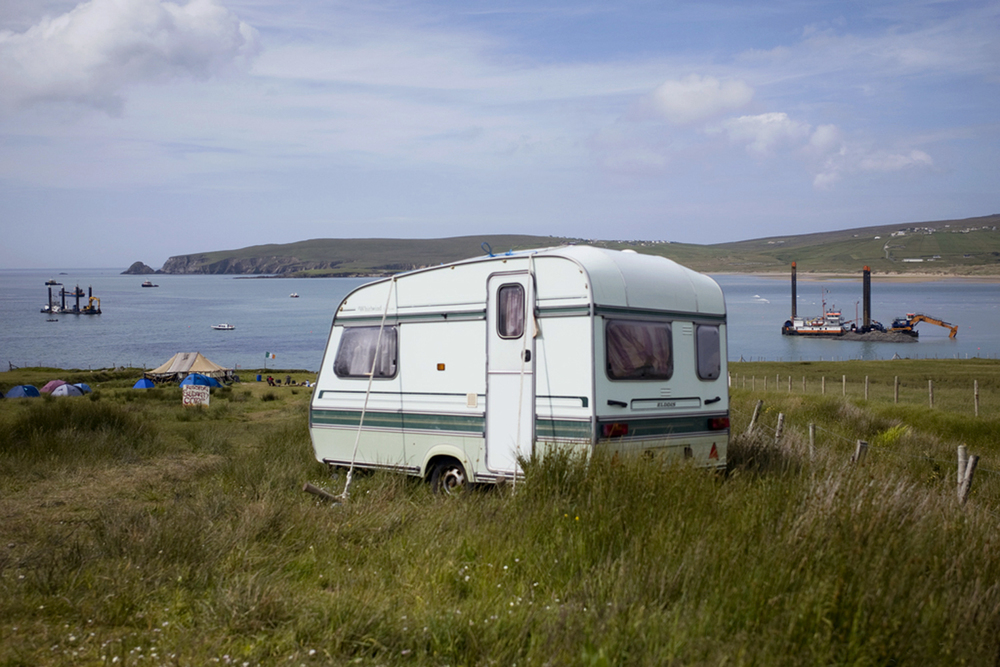 A documentary photograph of a caravan at the shell to sea site in the West of Ireland