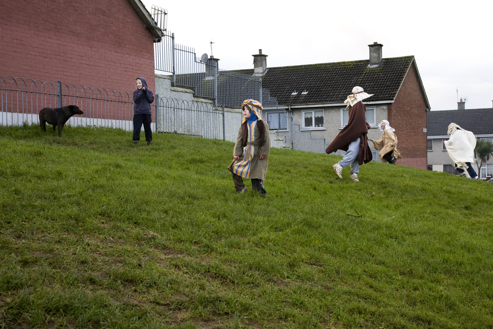 A documentary photograph of boys playing before the perform a live nativity scene with the monks of Moyross in Limerick City