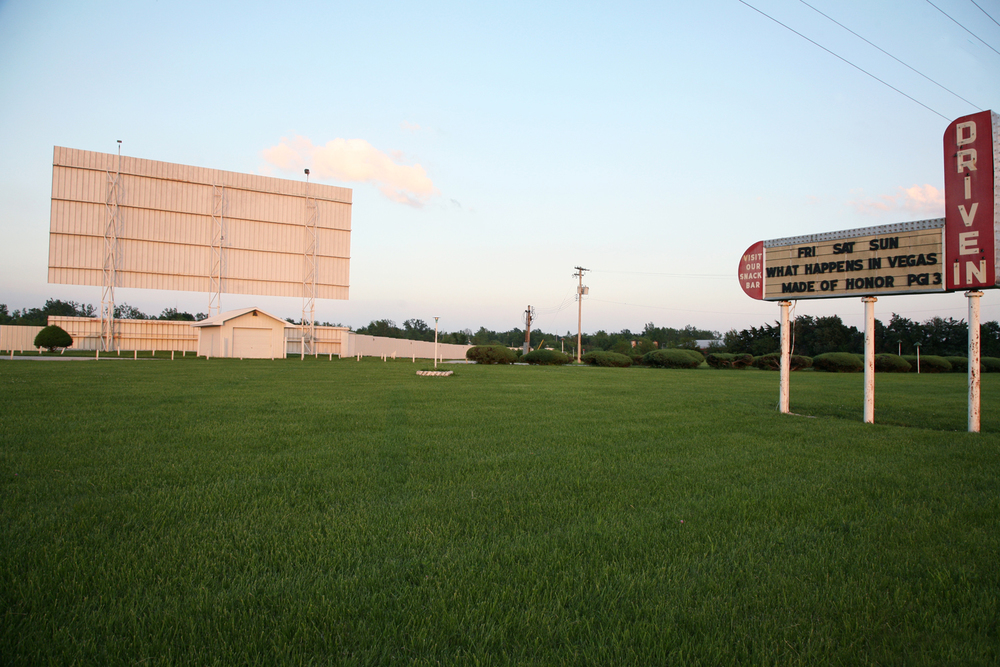 A documentary photograph of a drive in movie theater in the midwest of the united states