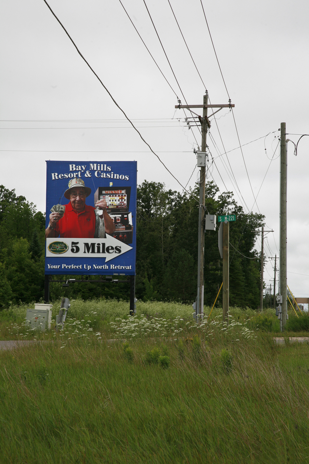 A documentary photograph of billboard advertising a casino in michigan