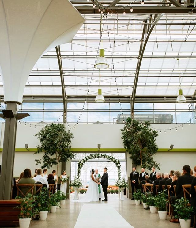"""Our Moonflower Room is the PERFECT place to say """"I do."""" An aisle lined with plants, a greenhouse filled with flowers as your backdrop and a blooming white arch to stand under — what more could you want for your special day?  Click the link in our bio to book your dream wedding today 💍"""