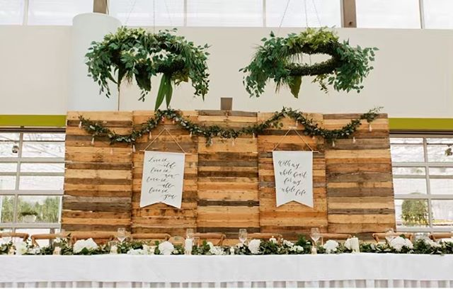 """Our reclaimed wooden backdrop is just one of the stunning decor items we have for #EventsAtHoles that can really bring the """"wow"""" factor to any event!  @winkinkdesignco created two custom faux leather banners for this bride and groom and we are LOVING IT 👏🏻😍"""