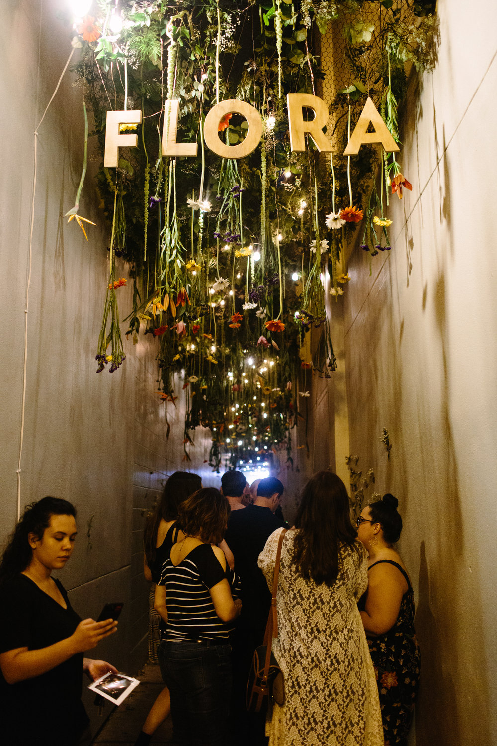 Hundreds of real flowers bring this alleyway to life as part of the Flora installation by Andre Bohrer. (photo : Jesse Walsh)
