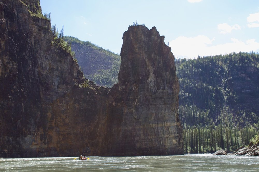 Nahanni River Paddling beneath Pulpit Rock.jpg