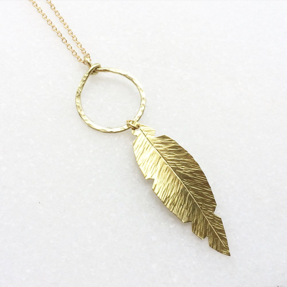 "Brass Feather on Ring 28"" Necklace                             $19-"