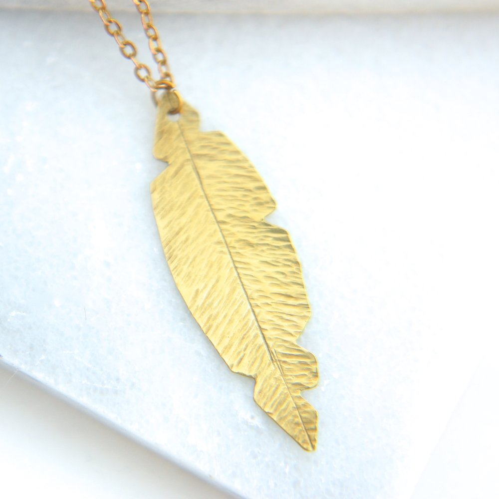 "Brass Feather 28"" Necklace                             $15-"