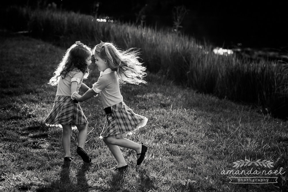 springfield ohio lifestyle family photographer | Amanda Noel Photography | twin girls 4th birthday | dance in sun | black and white