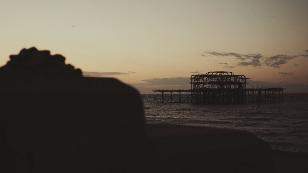 Walk along the Beach - First light in Brighton captured by James Miller
