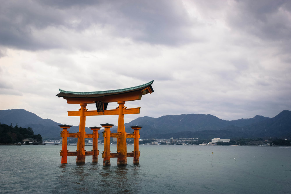 The floating Torii gate on Miyajima, a quick day trip from Hiroshima. When the tide is out, visitors can walk all the way up and through the Torii Gate. When the tide is in, it has the appearance of floating in the water.