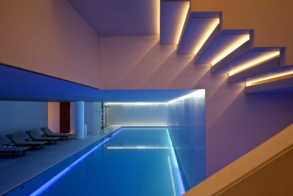 Swimming-Pool-Among-Decorative-Lighting-System-Also-Lounge-Nearby.jpeg