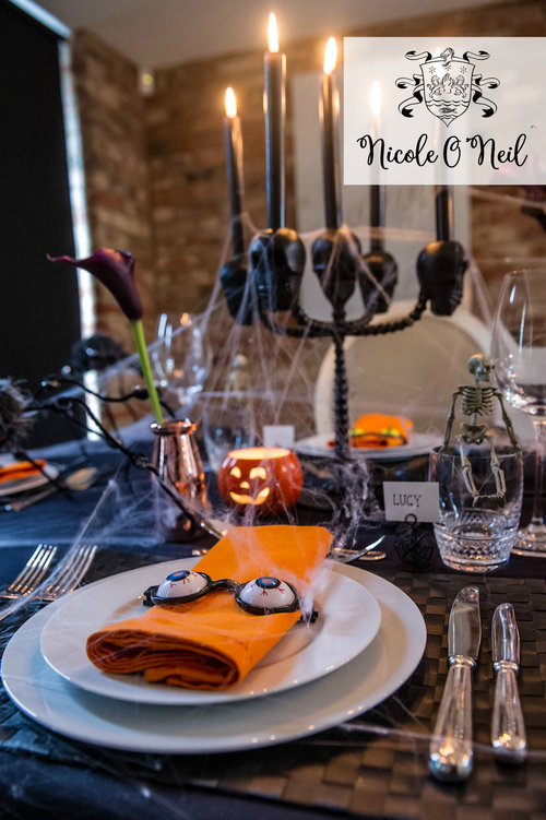 halloween party decoration ideas and halloween table setting inspiration skeleton candelabra centrepiece and fake spider