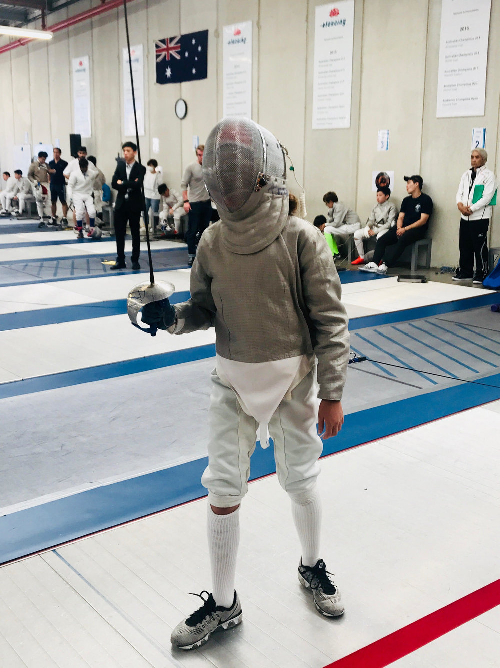 Nawal in her gear ready to fence.jpg