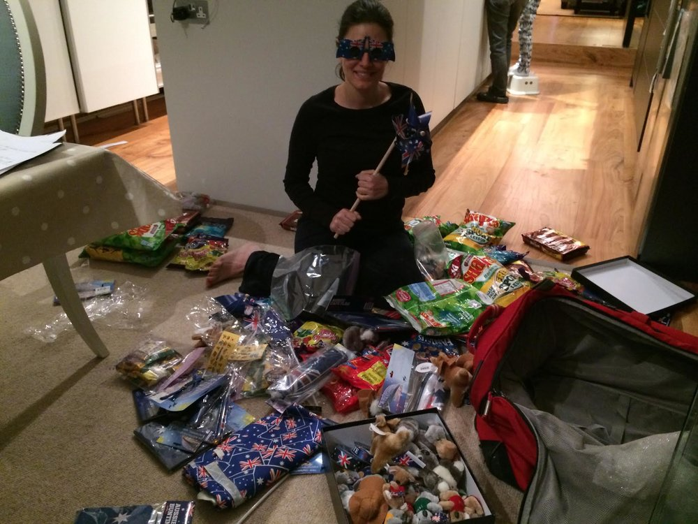 Nicole with a suitcase full of Australian treats.jpg